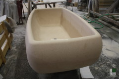 Bathtub carried out with monolithic Moka Cream stone