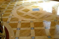 Foyer con pavimento intarsiato