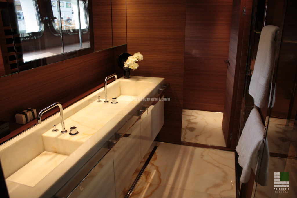 Washbasin and flooring panelled with White Onyx