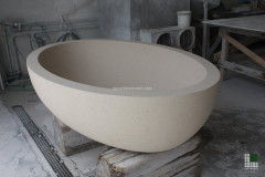 Bathtub realised with Bihara stone (or Moka Cream) and overflow drain
