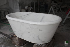 Monolithic bathtub realised with White Statuario marble and overflow drain