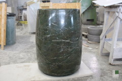 Freestanding washbasin realised with monolithic Green marble