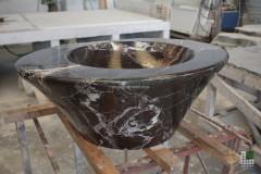 Monolithic washbasin realised with Rosso Levanto marble