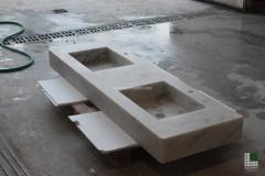 Monolithic washbasin realised with White Statuario marble