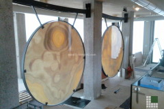 Installation of the Gongs realised with Orange Onyx on glass