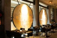 Gong retroilluminati, realizzati con Onice Arancio su vetro